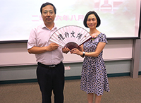 Prof. Wong Suk-Ying (right), Associate Vice-President of CUHK, presents a souvenir to Mr. Zhang Zongming, Deputy Inspector of the Education, Science and Technology Department, Liaison Office of The Central People's Government in the HKSAR